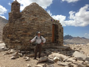 Standing in front of a refuge hut on Muir Pass.