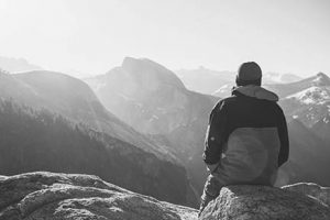 Hiker staring at mountains