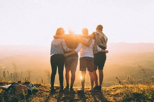 friends standing in summer sun