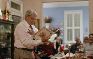 "Bishop Lawrence reads ""A Christmas Carol"" to Diocesan staff at Christmas party"